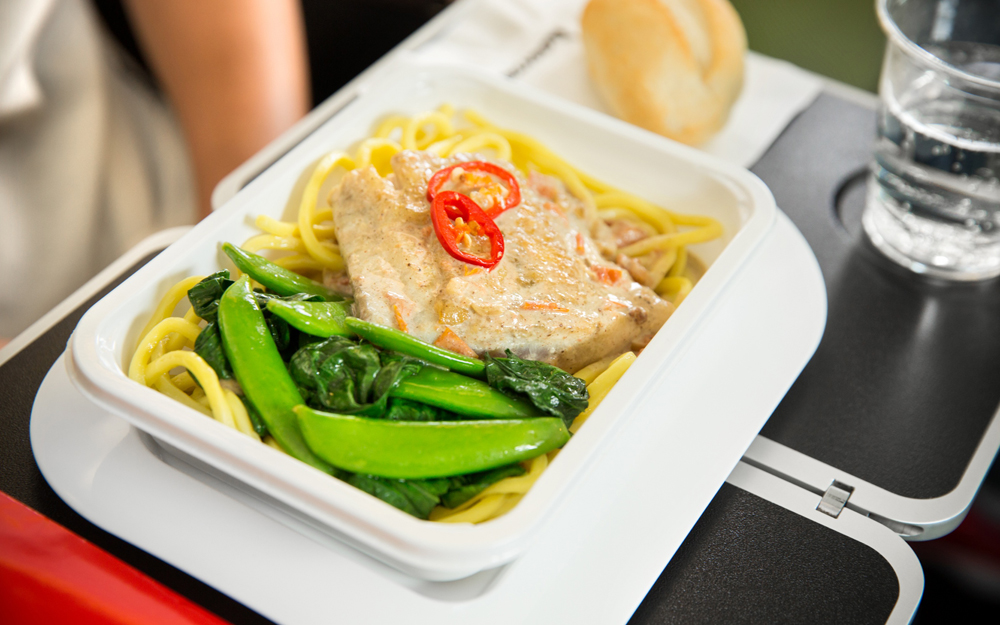 Barramundi poached in a lightly spiced coconut sauce with noodles, sugar snaps, choy sum and chilli[3]