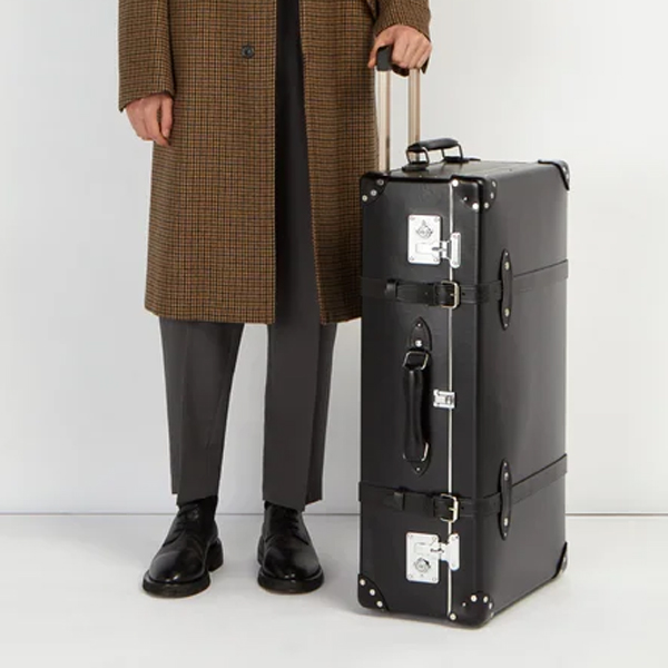 essential travel items Globe trotter luggage