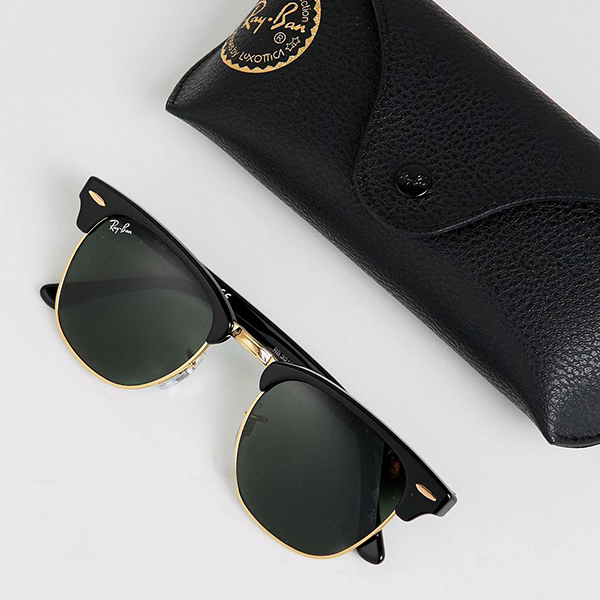 essential travel items ray-ban clubmaster sunglasses
